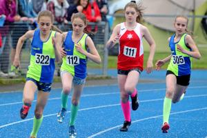 From left, Vale Royal Athletics Club's Holly Weedall (wearing 322), Alice Gale (112) and Grace Roberts (305) in the under 13s girls' 800m final at the Cheshire Track and Field Championships. Picture: Paul Heaps