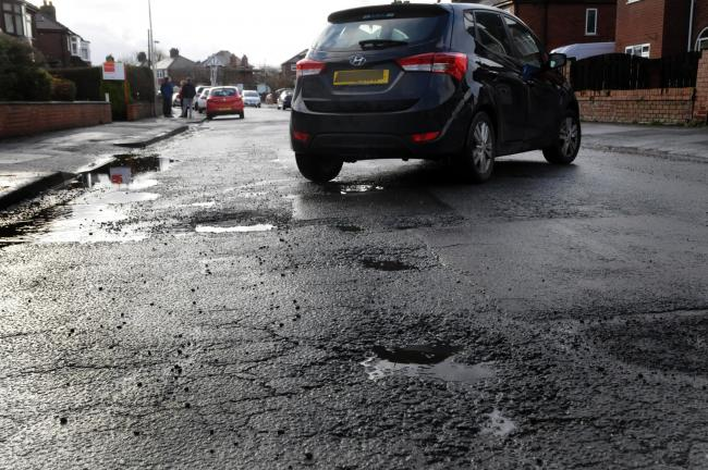Pothole complaints fall as roads spend increases